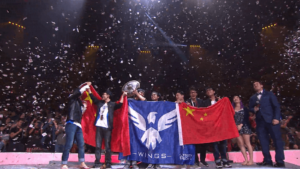Team Wings Gaming celebrating after winning $1,827,800 each.